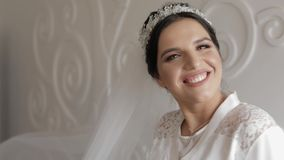 Beautiful and lovely bride in night gown and veil. Wedding morning. Slow motion. Beautiful and lovely bride in night gown and veil. Pretty and well-groomed woman stock video footage
