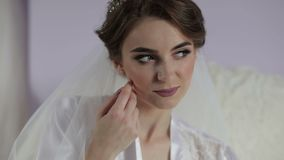 Beautiful and lovely bride in night gown. Wedding morning. Pretty and well-groomed woman. Slow motion.  stock video