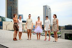 Beautiful lovely girls dancing in Vilnius city Stock Photo