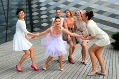 Beautiful lovely girls dancing in Vilnius city Royalty Free Stock Image