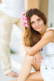 Beautiful lovely woman with flower hair accessory Stock Photos