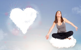 Beautiful lovely woman sitting on cloud with heart Royalty Free Stock Photo