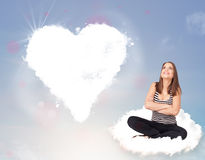 Beautiful lovely woman sitting on cloud with heart Stock Photography
