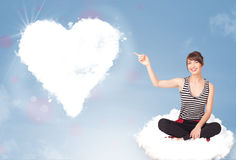 Beautiful lovely woman sitting on cloud with heart Stock Images