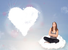 Beautiful lovely woman sitting on cloud with heart Royalty Free Stock Images