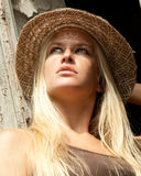 Beautiful  lovely woman with straw hat posing Royalty Free Stock Photo