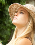 Beautiful  lovely woman with straw hat posing Royalty Free Stock Photos
