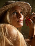 Beautiful Lovely Woman With Straw Hat Posing Royalty Free Stock Photography