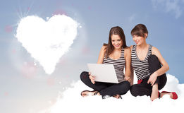 Beautiful lovely women sitting on cloud with heart Royalty Free Stock Photography
