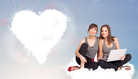 Beautiful lovely women sitting on cloud with heart Stock Photography