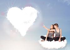 Beautiful lovely women sitting on cloud with heart Stock Images