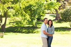 Beautiful lovers in the park Stock Image