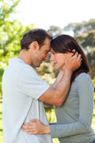 Beautiful lovers in the park Royalty Free Stock Image