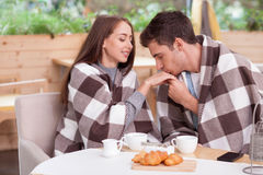 Beautiful loving couple is dating in cafeteria Stock Photography