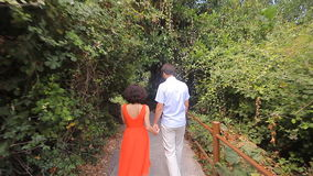 Beautiful loving couple going for a walk outdoors. Forest stock video footage