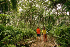 Beautiful loving couple going for a walk outdoors in a tropical. Forest Royalty Free Stock Image