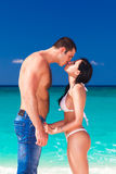 Beautiful loving couple kissing on the tropical coast Royalty Free Stock Photo