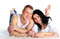 Beautiful loving couple lying on the floor Stock Photos