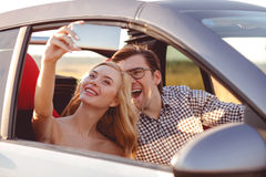 Beautiful loving couple is photographing Royalty Free Stock Photo
