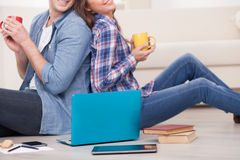 Beautiful loving couple with tea and laptop Royalty Free Stock Photo
