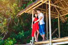 beautiful loving couple in tropical hut Royalty Free Stock Photography