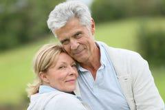 Beautiful loving senior couple outdoors Stock Images