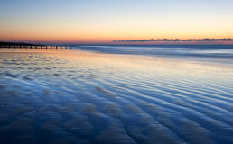 Beautiful low tide beach vibrant sunrise Stock Photography