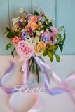 Beautiful lush bouquet with roses, turquoise background, gift Royalty Free Stock Image
