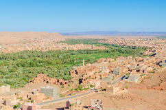 Beautiful lush green oasis with buildings and mountains at Todra Gorge, Morocco, North Africa Stock Photos