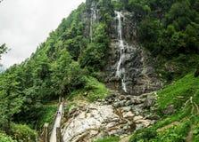 Beautiful Lush Waterfall. Mencune Waterfall, Beautiful Lush Waterfall royalty free stock photography