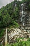 Beautiful Lush Waterfall. Mencune Waterfall, Beautiful Lush Waterfall royalty free stock photos