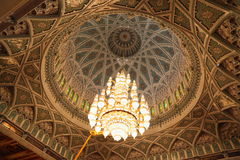 Beautiful lustre in a hall of Grand Mosque in Oman. Big beautiful lustre in a hall of Grand Mosque in Oman. the lights is on royalty free stock photos