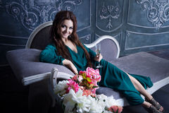 Beautiful luxurious woman with a glass of Royalty Free Stock Images