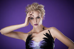 Beautiful luxurious woman on purple background Royalty Free Stock Images