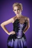Beautiful luxurious woman on purple background Stock Image