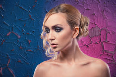 Beautiful luxurious woman on purple background with cracked pain Royalty Free Stock Photo