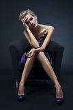 Beautiful luxurious woman sitting on chair Royalty Free Stock Photo