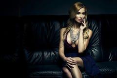 Beautiful luxurious woman sitting Royalty Free Stock Image