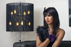 Beautiful luxurious woman sitting & sensually posing Stock Images