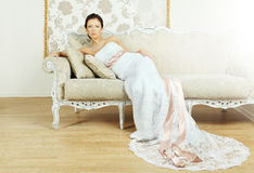 Beautiful luxurious woman on a sofa Stock Photography