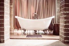 Beautiful luxury bathtub. Beautiful luxury vintage bathtub decoration in bathroom interior - Vintage filter Stock Photo