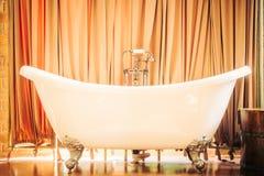 Beautiful luxury bathtub. Beautiful luxury vintage bathtub decoration in bathroom interior - Vintage filter Royalty Free Stock Image