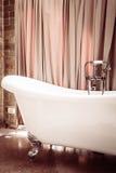 Beautiful luxury bathtub. Beautiful luxury vintage bathtub decoration in bathroom interior - Vintage filter Stock Image
