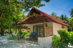 Beautiful luxury beach house located at the tropical resort. In Maldives Royalty Free Stock Image