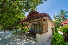 Beautiful luxury beach villa located at the tropical resort. In Maldives Royalty Free Stock Photo