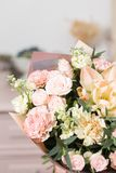 Beautiful luxury bouquet of mixed flowers in woman hand. the work of the florist at a flower shop. Cute lovely girl Stock Images