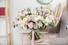 Beautiful Luxury Bouquet Of Mixed Flowers In Woman Hand. The Work Of The Florist At A Flower Shop. Wedding Royalty Free Stock Photos