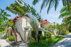Beautiful luxury cottages located at the tropical resort Stock Photos
