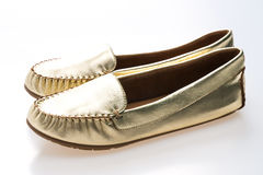 Beautiful luxury fashion golden woman shoes Royalty Free Stock Photos