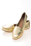 Beautiful luxury fashion golden woman shoes Royalty Free Stock Photography